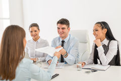 Job Interview. Young businesswoman in front of the commission having a job interview royalty free stock photo