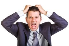 This job is killing me!!!. Young caucasian man in a suite, screaming and pulling his hair, isolated on white Stock Image
