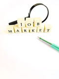Job market. Studying about the job market, a concept photograph with the words job market spelt in block letters, taken with green pen and magnifying glass on Royalty Free Stock Image