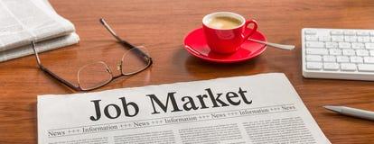 Job Market. A newspaper on a wooden desk - Job Market Royalty Free Stock Photography