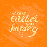 Job motivation lettering wake up earlier - work harder Stock Photo