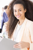 This job is my passion. Shot of a young pretty smiling businesswoman Royalty Free Stock Photos