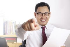 Job Offer Concept, Businessman Pointing Forward While Holding Empty Paper stock photos