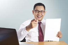 Job Offer Concept, Businessman Pointing Forward While Holding Empty Paper royalty free stock images