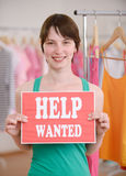Job offer: Woman with Help Wanted sign Stock Image