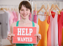 Job offer: Woman with Help Wanted sign. Job offer: Store owner holding Help Wanted sign Royalty Free Stock Photography