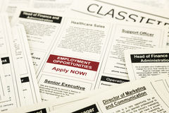 Job opportunity classifieds ads, apply now. Newspaper with advertisements and classifieds ads for vacancy, employment opportunities royalty free stock photo