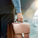 Job opportunity. Closeup Of A Businessman Holding Briefcase Going To Work Royalty Free Stock Images