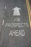 Job Prospects Ahead. Sign in white text on a road surface with a white arrow royalty free stock photography
