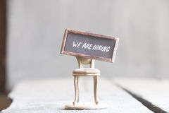 Job recruiting idea WE ARE HIRING - tag on the golden chair Royalty Free Stock Image