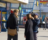 job of a reporter on street. interview people on camera TV Royalty Free Stock Photography