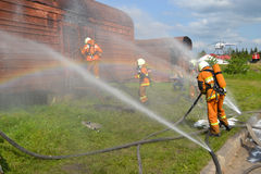 Job rescuer. Fire rescue eliminate fire. NFire rescue eliminate fire. Well coordinated work of rescuers in case of liquidation of dangerous situations royalty free stock photography