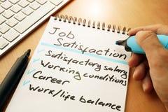Job satisfaction list written by hand. Job satisfaction list written by hand in a note Stock Photos