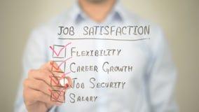 Job Satisfaction, Mens die op het transparante scherm schrijven Stock Foto's