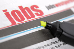 Job search. Job listing pages of a newspaper with highlighter pen Stock Images