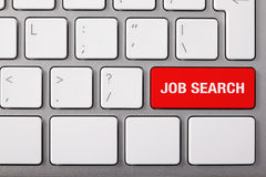 Job search. Laptop keyboard and red key JOB SEARCH on it Stock Photo