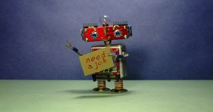 Job search advert. Unemployed red robot wants to get a job. Funny toy robot walking with a cardboard sign and stock video