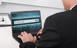 Job Search. Business man with laptop. Job Search Royalty Free Stock Photography