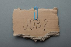 Job search in a crisis, poverty. The inscription on the torn cardboard royalty free stock image