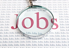 Job search with a magnifying glass. Background Stock Photos