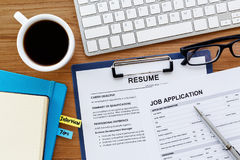 Job search. With resume and job application on computer work table Stock Photos