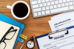 Job search with wood desk background Royalty Free Stock Images