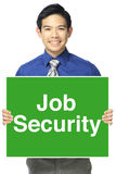 Job Security. A happy office person holding a sign indicating Job Security Royalty Free Stock Images