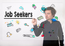 Job Seekers concept. Businessman writing with black marker on vi Stock Image