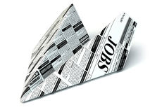 Job seeking concept. Newspaper as paper airplane. Stock Photo