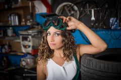 Job in the service station. The girl in the mask working at the bench. Hard work for women. Master welder, Working profession. Where to go to study. Work stock image