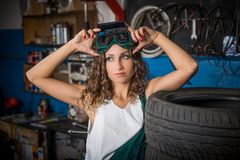 Job in the service station. The girl in the mask working at the bench. Hard work for women. Master welder, Working profession. Where to go to study. Work royalty free stock photography