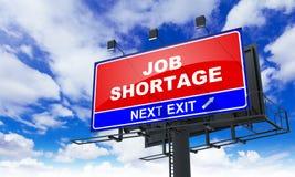 Job Shortage Inscription auf roter Anschlagtafel Lizenzfreie Stockfotografie