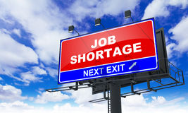 Job Shortage Inscription on Red Billboard. Royalty Free Stock Photography