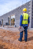 Job Supervisor Looks Over Building Project Royalty Free Stock Photos