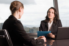 Job talk in business office. Two businesswoman in an office talking stock photography