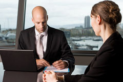 Job talk in business office. Two persons in a meeting royalty free stock photo