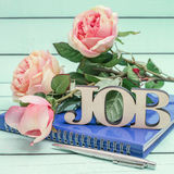 Job text and notebook with roses Stock Image