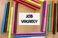 Job vacancy concept. Job vacancy written on memo over wooden background Stock Photo