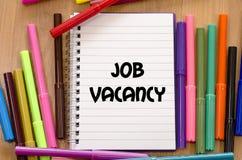 Job vacancy concept. Job vacancy written on notebook over wooden background Royalty Free Stock Photos