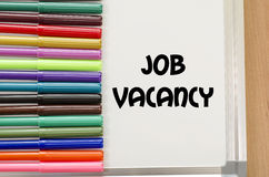 Job vacancy concept. Job vacancy written on whiteboard over wooden background Royalty Free Stock Photo