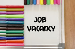 Job vacancy concept. Job vacancy written on whiteboard over wooden background Royalty Free Stock Photography