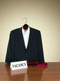 Job vacancy - desk with business suit on hanger, tie Royalty Free Stock Photo
