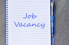Job vacancy write on notebook. Job vacancy text concept write on notebook with pen Stock Photo