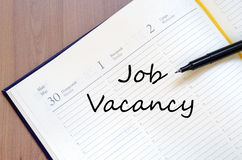 Job vacancy write on notebook Royalty Free Stock Photography