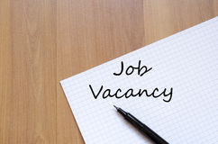 Job vacancy write on notebook Royalty Free Stock Photos