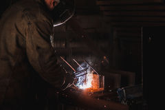 Job of a welder. A large concrete products plant and welding on it. Stock Images
