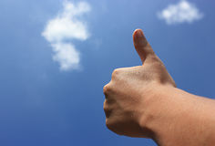 A job well done. A thumb reaches to the sky signaling a great job well done stock photo