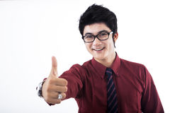 Job well done!. Young businessman raise his thumb to praise his colleague of job well done, isolated on white stock photography