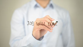 Job Well Done , Man writing on transparent screen. High quality stock photo