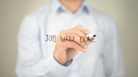 Job Well Done, Mens die op het transparante scherm schrijven stock foto